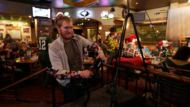 USA TODAY NETWORK-Wisconsin photographer Danny Damiani works during the annual Christmas show at Clubhouse Live.