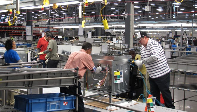 Workers assemble ovens at an Electrolux home cooking appliance factory in Memphis, Tenn.