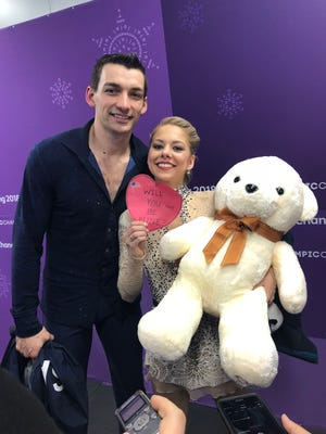 U.S. pairs skaters Chris and Alexa Scimeca Knierim celebrate Valentine's Day after skating the short program at the Pyeongchang Winter Games