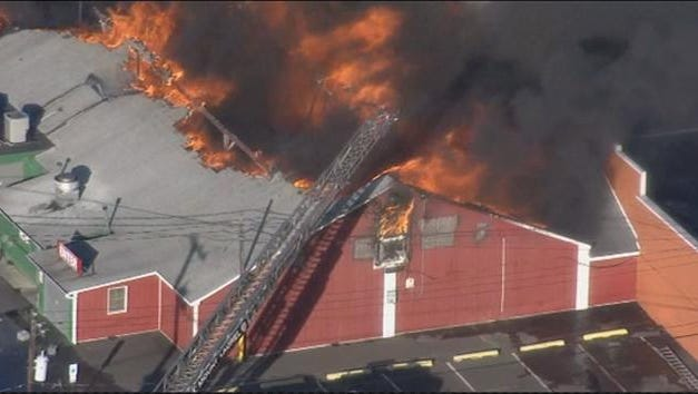 Heavy smoke and flames could be seen erupting from the roof of a building at Columbus Farmers Market in Springfield.