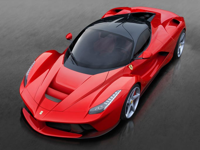 """The LaFerrari super car is the first """"mild hybrid"""" built by Ferrari, with a rear-mounted 6.3-liter V12, an electric motor and KERS to deliver high power output while reducing fuel consumption by 40 percent."""