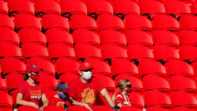 Fans wearing face masks watch the Kansas City Chiefs during a training camp session Saturday at Arrowhead Stadium. The Chiefs opened the stadium to 2,000 season ticket holders to watch practice.