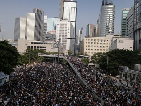 Pro-democracy protesters flood the streets around the government headquarters on Monday, Sept. 29, 2014, in Hong Kong. Pro-democracy protesters expanded their rallies throughout Hong Kong on Monday, defying calls to disperse in a major pushback against the Chinese government's decision to limit democratic reforms in the Asian financial hub.