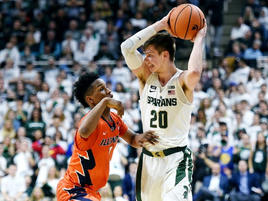 Michigan State's Matt McQuaid, right, is pressured