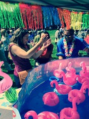 Corning Inc. employees recently kicked off the company's local United Way campaign with a Hawaiian luau-themed event in Riverside Centennial Park.