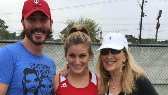 Brittni Clements, center, stands with C. J. Clements, left and Debbie Phelps Clements.