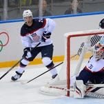 Ryan Callahan of Greece moves the puck as Slovakia goalie Peter Budaj reacts during Thursday's game.