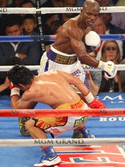 Tim Bradley punches Manny Pacquiao during their fight