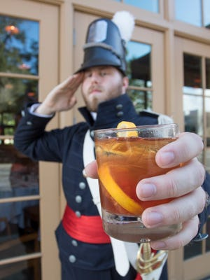 Jacksonian Guard member Jonathan Woodward salutes a 23 Star Salute cocktail at Jackson's Steakhouse in Pensacola on Friday, February 24, 2017.