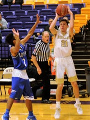 Abilene High's Nic Marczynski takes a shot against