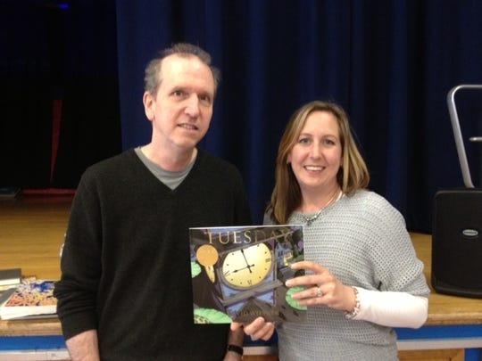 """Author and illustrator David Wiesner visited students at Adamsville Elementary School in Bridgewater on April 8. Wiesner has won the Randolph Caldecott Medal three times for the most distinguished American picture book for children: """"Tuesday"""" (1991), """"The Three Pigs"""" (2002), and """"Flotsam"""" (2007). He has also received Caldecott Honors for three other titles, including his latest, """"Mr. Wuffles"""" (2014). Students enjoyed learning about using imagination, sketching, and how ideas and thoughts become a full story. Also interesting to students was that Wiesner had attended Adamsville School when he was a child. He is pictured with Adamsville's Media Specialist Kelly Mumber."""