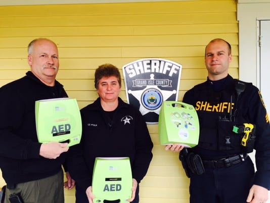 Sheriff Ray Allen with AEDs