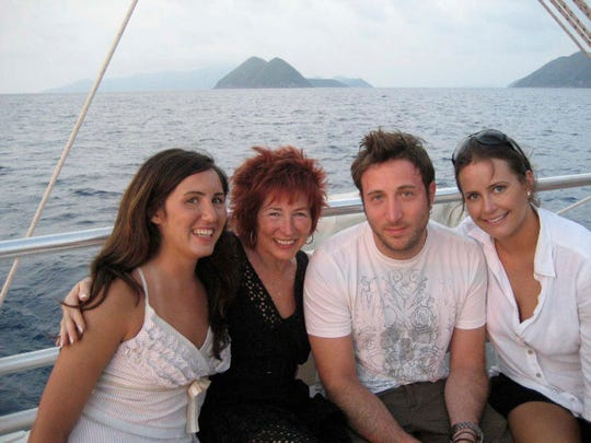 Ellen Zionts enjoys a boat ride with her daughter, Suzanne Zionts (left), son, James McGorman and daughter-in-law Janey Strouse McGorman. The death of her cat inspired a lifetime of delayed mourning for losses in Zionts, including the empty nest.