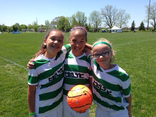 Waiting for the second half of Saturday's Michigan Bucks game at the Canton Cup are (from left) Natalie Nissen, Mya Sheridan and Mae Ridalls. All are players on the Canton Celtic 05 Green girls team.