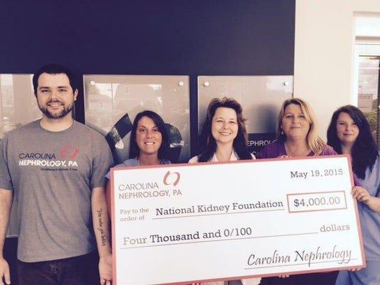 Staff at Carolina Nephrology presents the National Kidney Foundation with a
