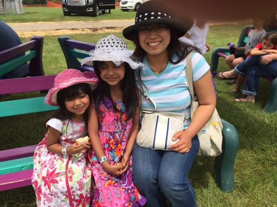 Canton mom Yoko Telang with daughters Aleina, 7, and Celica, 3, at Liberty Fest