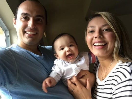 Armid Metohu with his 8-month-old son, Maximillian and wife, Jessie