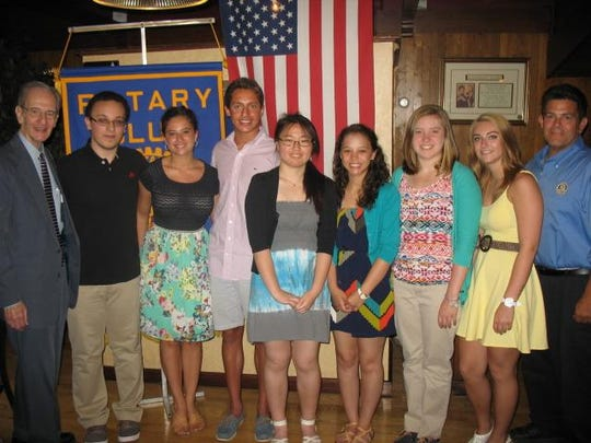 Scholarships were given out this spring by the Dunellen-Green Brook Rotary Club. Left to right: Club member Bill Mundy, and Mark Armanious, Isabella Perone, Nicholas Berger of Watchung Hills Regional High Schoolin Warren; Herg Shang Carolyn Doyle, Jillian Breckenridge, and Megan Bollenbach of Dunellen High School; and Club President Joe Spera. Not pictured in Watchung Hills honoree Kaila Davis.