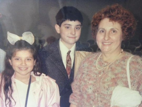 Giorgina Cimino, at age 10, with her brother and her mother, Angela Cimino.