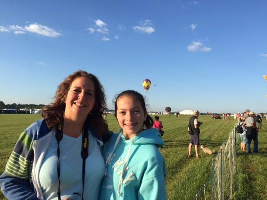 Amy Matza of Whitehouse Station and her daughter, Emma, 12, at the New Jersey Festival of Ballooning at Solberg Airport on Friday morning.