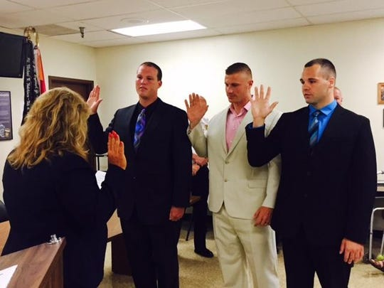 Freeman Nixon, center, was one of three new Mansfield police officers sworn in by Safety-Service Director Lori Cope in this 2015 file photo. Also taking the oath are Nolan A. Goodman, left, and Heath Underwood.
