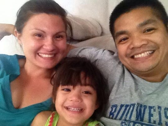 Joann Kurcan and Michael Fernandez are shown here with their 4-year-old daughter, Sophia.