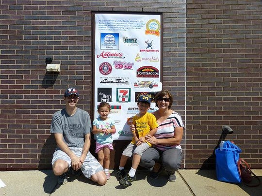 The Martin family – Andy, Elizabeth and children Olivia, 2, and Samuel, 4 – were among those attending the library's summer program. They received recognition as the Super Mega Ultra prize.
