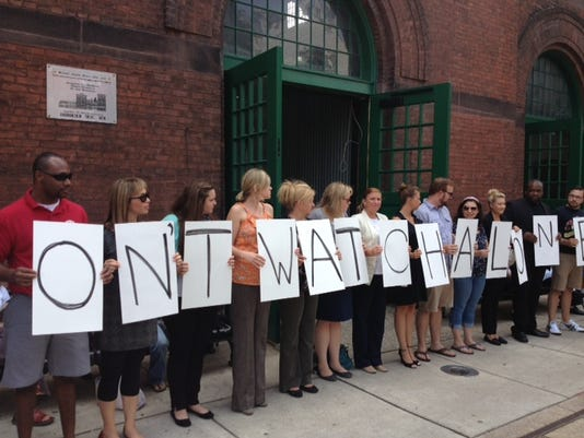 People participate in the filming of a Dateline #dontwatchalone promo in front of Central Market in York Tuesday.