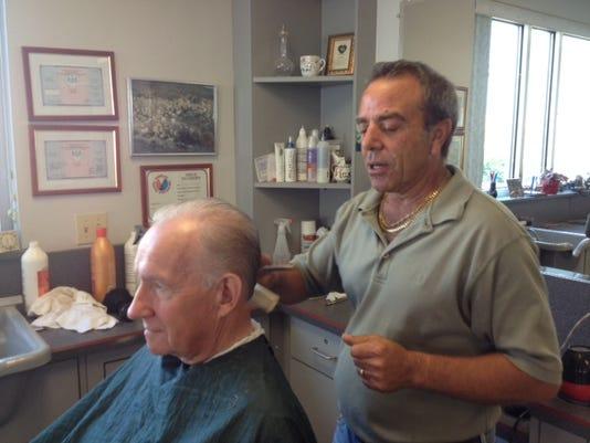 Steve Licatese cuts a customer's hair in his Springettsbury Township shop. DAILY RECORD/SUNDAY NEWS -- Lauren Boyer