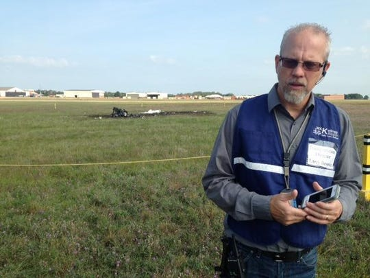 City of Battle Creek Transportation Director Larry Bowron spoke to reporters Friday at the scene of Thursday's fatal airplane crash on the field at W.K. Kellogg Airport.