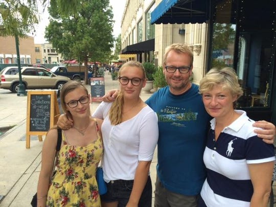 Like much of North Carolina, Asheville has enjoyed a spike in international tourists. On a recent afternoon, this family from Germany strolled the downtown on a shopping excursion. From left to right are sisters Magdalena and Claudia Westenhoff, Dirk Boettcher, and the girls' mother, Christine Westenhoff.