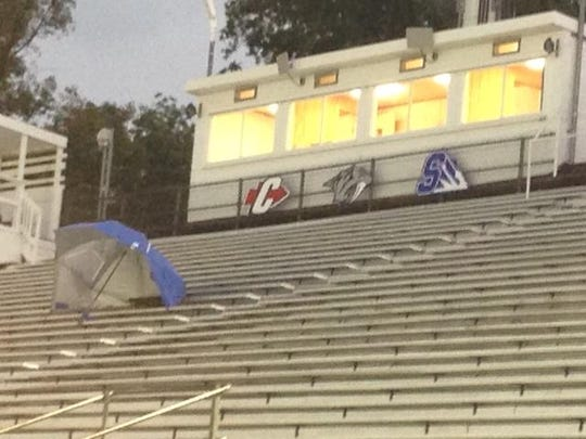 While spectators and teams waited to see if football would be played Thursday at the Park, a solitary blue umbrella rested in the empty bleachers in front of the press box.