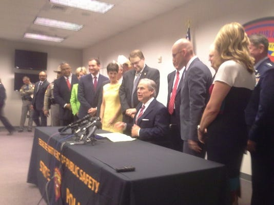 Gov. Greg Abbott is seen signing a sweeping $800M series of border security measures.