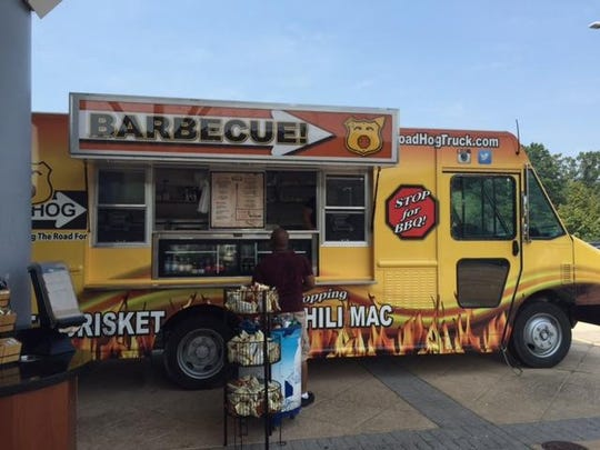 Road Hog, a new barbecue food truck parked in front of the Delaware Welcome Center Travel Plaza's main entrance, caters to travelers who need more than just a light snack.