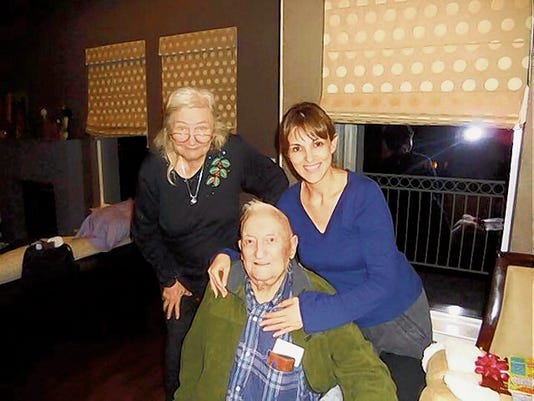 Harry Edward Steen Sr., seen here with his wife Mary Lou Steen, left, and Marcia MacCardle in 2008 during a gathering. Steen, El Paso's sole remaining survivor of the Bataan Death March in World War II, passed away Saturday in his East Side home. He was 97.
