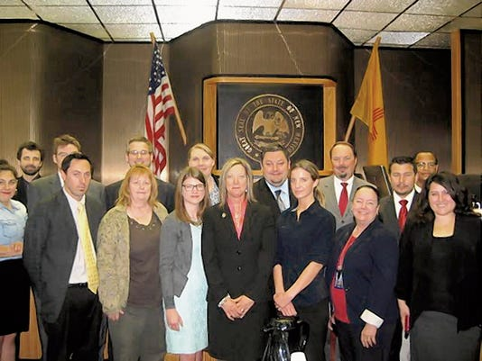 Courtesy Photo   Dianna Luce, center, is sworn in at District Attorney for the Fifth Judicial District June 26.