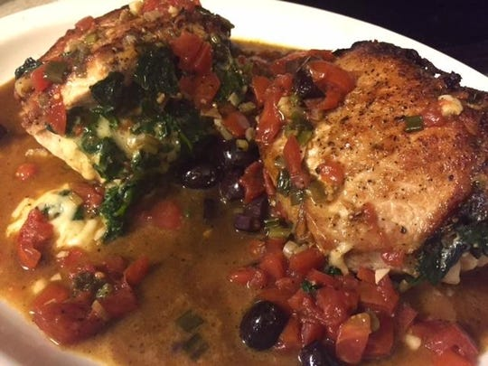 Pork chops stuffed with spinach and Gruyere cheese
