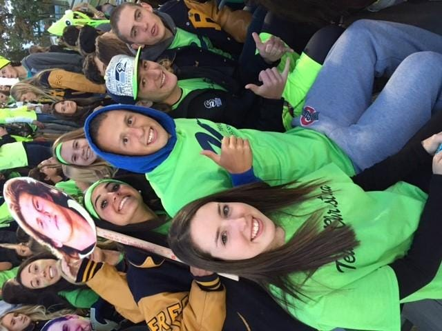 The Roxbury student section wore bright green T-shirts in support of alumna Christina Alecci-Adamski, who is battling Lyme disease.