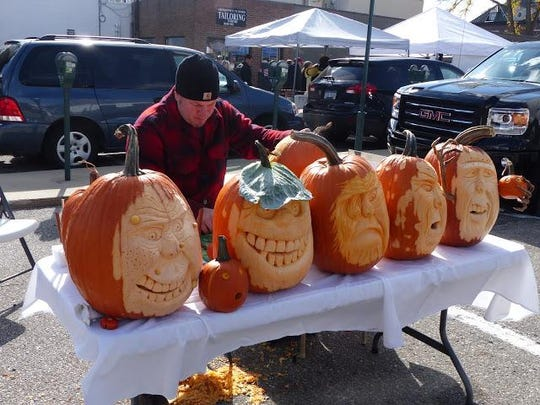 Pumpkin carver Doug Gahns, an instructor in the culinary program at Oakland Community College, displays his craft at the Birmingham Farmers Market.