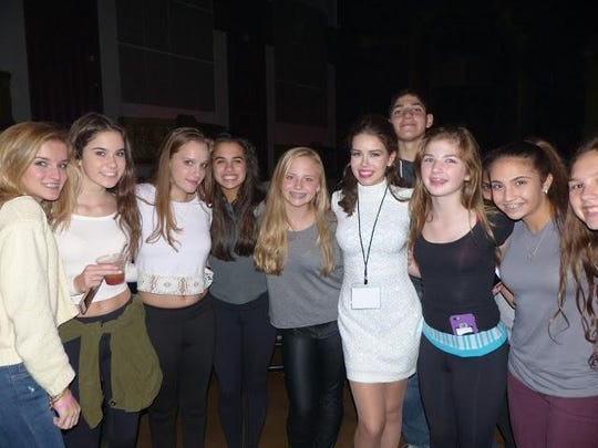 Sofi K (white dress) had a lot of encouragement and support from friends at her concert performance in Royal Oak.