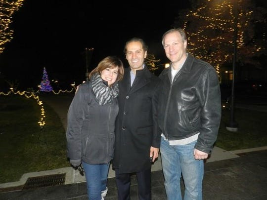 Judy and David Karp with Birmingham City Commissioner Pierre Boutros (center) at the menorah lighting in Shain Park.