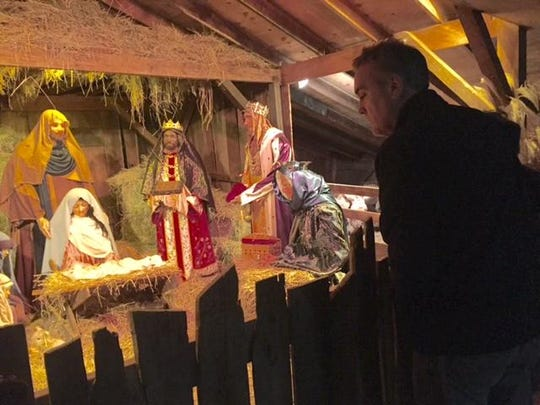 A local Nativity scene with the baby Jesus at the center