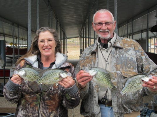 Tina and Dennis Hymer of Strafford display some of the winter crappies they caught recently from Stockton Lake.