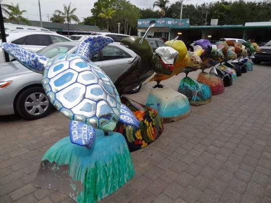 Group 2William C. Huff Moving & Storage transported the Turtles on the Town sculptures to Supreme Auto Collision in Naples so the auto shop employees could spray them with a clear coat to protect the artists' work.