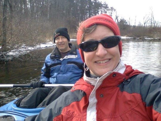 Desiree Jacques Rinkel and her husband Craig took advantage of the balmy temperatures and dropped their kayaks into the Huron River at the Proud Lake State Rec Area launch near Commerce Township in Oakland County.