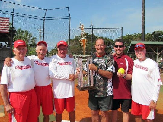 Stonewalls enjoys the moment: from left, statistician Chuck Cornellie, coach Scott Byers, manager Peter Karl, Commissioner Bill Shurina, Stonewall sponsor Tim Burke, coach Tom Porter.