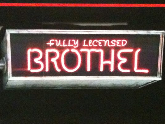 fully licensed brothel sign