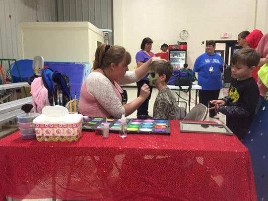 Face-painting was available Saturday as many gathered to bid farewell to Malesus Elementary.