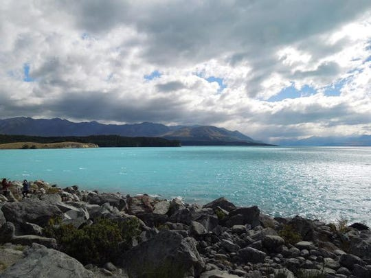 A brilliant turquoise lake is fed by Mount Cook and