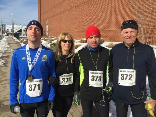 Alex, Robyn, Jamie and Allan Schneider at a run in